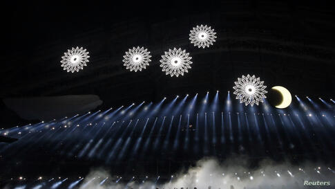 Actors perform during the opening ceremony of the 2014 Sochi Winter Olympic Games, Feb. 7, 2014.