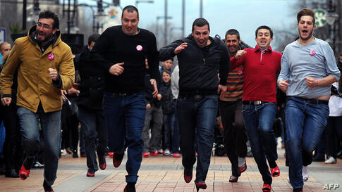 """Bulgarian men wearing high heels run during the second edition of Bulgaria's """"Walk a Mile in Her Shoes"""", in Sofia as part of an international awareness campaign designed to raise awareness and stop rape, sexual assault and gender violence."""