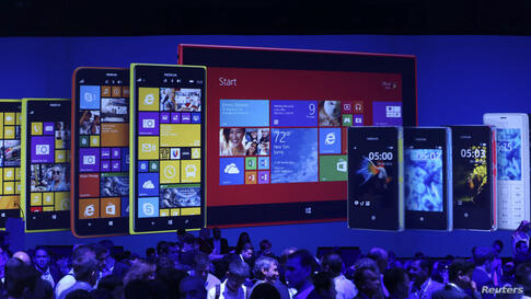 People attend a Nokia launch ceremony in Abu Dhabi, United Arab Emirates. Nokia unveiled its first tablet and two large-screen smartphones, known as phablets, at the annual Nokia World event in Abu Dhabi.