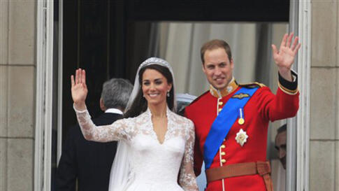 Britain's Prince William and his wife Kate, Duchess of Cambridge wave from the balcony of Buckingham Palace after the Royal Wedding in London Friday, April, 29, 2011. (AP Photo/Matt Dunham)