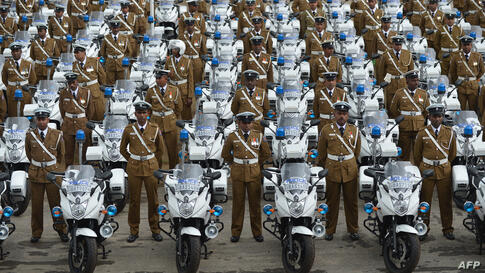 Sri Lankan policemen stand next to their new motorcycles at a ceremony in Colombo marking the official distribution of 279 high-powered units to traffic constables across the country.