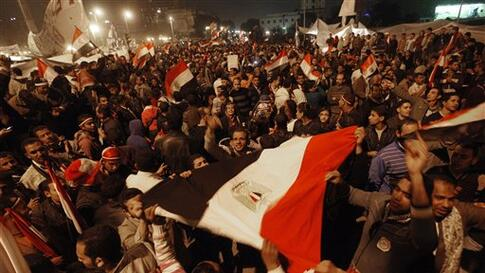 Egyptian citizens wave their country's flag as they celebrate after President Hosni Mubarak resigned and handed power to the military at Tahrir square, in Cairo, Egypt, Friday, Feb. 11, 2011. Egypt exploded with joy, tears, and relief after pro-democracy