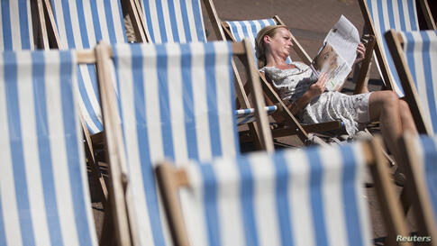 A woman relaxes in a deckchair in Victoria Embankment Gardens during a hot day in London. Parts of Great Britain were expected to experience the hottest day of the year so far.