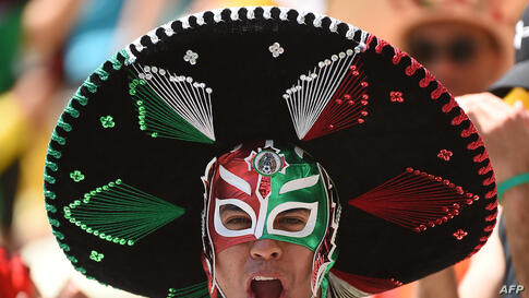 A Mexican supporter cheers for his team ahead of the Round of 16 football match between Netherlands and Mexico at Castelao Stadium in Fortaleza, Brazil, during the 2014 FIFA World Cup.