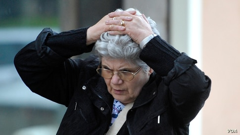 A woman holds her head in despair in Finale Emilia northern Italy, May 20 2012. AP Photo/Marco Vasini