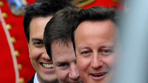 (L-R) Britain's opposition Labour Party leader Ed Miliband, Deputy Prime Minister Nick Clegg and Prime Minister David Cameron after the ceremony. (Reuters/Toby Melville)