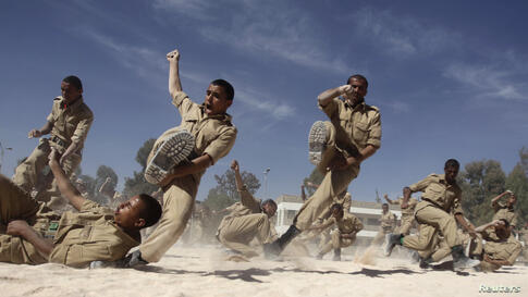Newly recruited members of the Yemeni military police force participate in exercises at their barracks in Sana'a.