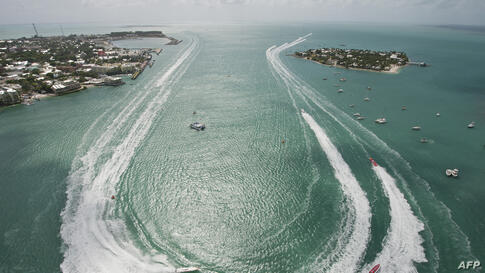 Superboat Extreme class boats make the turn in Key West Harbor during the first of three race days at the Key West World Championship in Key West, Florida, Nov. 6, USA. More than 40 high-speed powerboats from the U.S. and other countries are entered in...