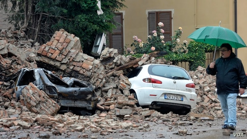 A man looks at the damage caused by a quake in Finale Emilia northern Italy, May 20. 2012. (AP Photo/Marco Vasini)