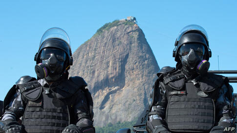 "Policemen of the ""Choque"" special unit pose during the presentation of security forces for the upcoming FIFA World Cup, in Flamengo beach in Rio de Janeiro."