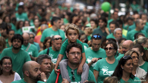 Protesters march during a rally in support of striking teachers in Palma, on the Spanish island of Mallorca. Teachers have been on an indefinite strike since the start of the school year in protest of a law to implement trilingualism (Catalan, Spanish ...