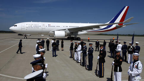 An American Honor Guard greets the French Delegation as their plane arrives at Dulles International Airport in Virginia, May 18, 2012, for the attend the G8 Summit.