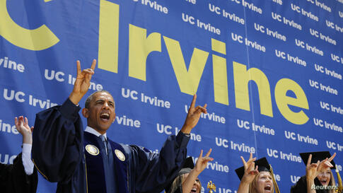 """U.S. President Barack Obama yells """"Zot! Zot! Zot!"""" to honor the school mascot, the anteater, as he attends the commencement ceremony for the University of California, Irvine at Angels Stadium in Anaheim, California, June 14, 2014."""