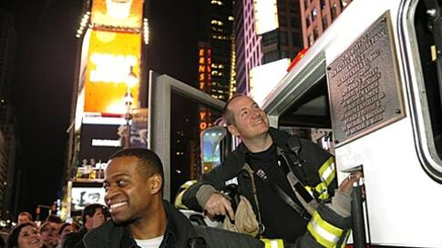 New York City firefighters gather in Times Square New York May 2, 2011 shortly after the announcement from the President  Obama announced that Al-Qaida mastermind Osama bin Laden was dead and the United States has his body, May 2, 2011.