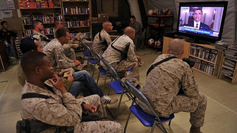 US Marines of Regiment Combat Team 1 (RCT 1) watch TV as President Barack Obama announces the death of Osama Bin Laden, at Camp Dwyer in Helman Province, on May 2, 2011. US President Barack Obama said on May 1, 2011 that justice had been done after the Se