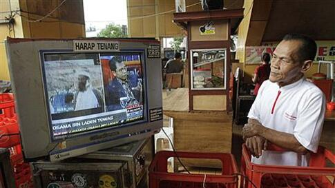 A man watches a TV news reporting the death of Osama bin Laden, in Jakarta, Indonesia, Monday, May 2, 2011. Bin Laden, the world's most-wanted man and the elusive mastermind behind the devastating Sept. 11, 2001, terror attacks, was slain in his luxury hi