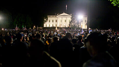 People gather at the White House in Washignton, D.C. to celebrate the death of Osama bin Laden, May 2, 2011.
