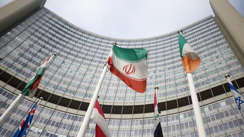 The Iranian flag waves in front of the International Atomic Energy Agency (IAEA) headquarters, amid the coronavirus disease …