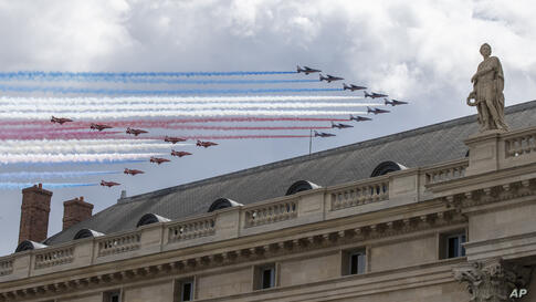 French Alpha jets of the Patrouille de France followed by the Red Arrows, officially known as the Royal Air Force Aerobatic…