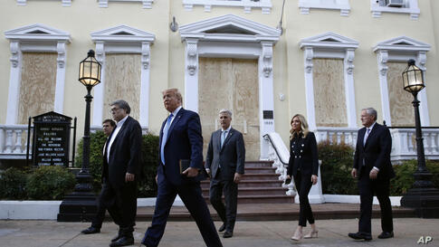 President Donald Trump departs after visiting outside St. John's Church across Lafayette Park from the White House Monday, June…