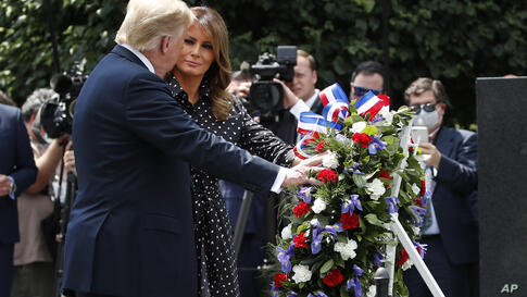 President Donald Trump, accompanied by first lady Melania Trump, places a wreath at the Korean War Veterans Memorial, Thursday,…