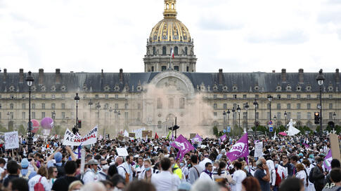 Hospital workers march during a demonstration, Tuesday, June 16, 2020 in Paris. French hospital workers and others are…