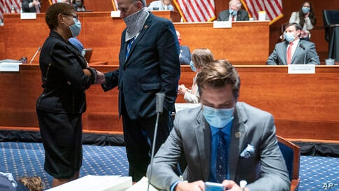 Rep. Karen Bass, D-Calif., left, speaks with Rep. Louie Gohmert, R-Texas, during a House Judiciary Committee markup of the…