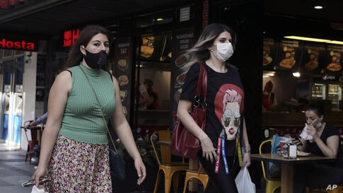Women wearing face masks to protect against the spread of coronavirus, walk in the city centre, in Ankara, Turkey, Wednesday,…