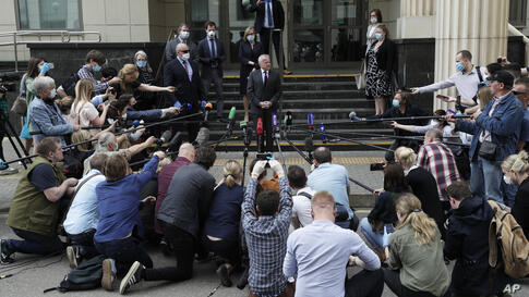 U.S. Ambassador to Russia John Sullivan speaks to the media at the Moscow City Court building after the verdict announcement…