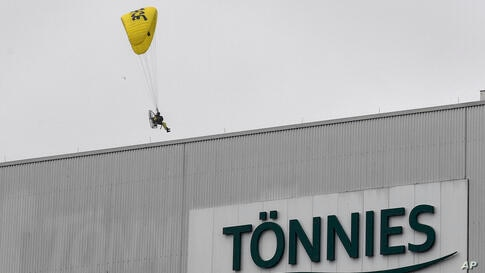 Greenpeace activists land on the roof of the reopened Toennies meatpacking plant, Europe's biggest slaughterhouse, in Rheda…