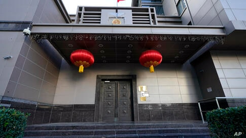 The flag of China flies outside the Chinese Consulate General Wednesday, July 22, 2020, in Houston. Houston police and fire…
