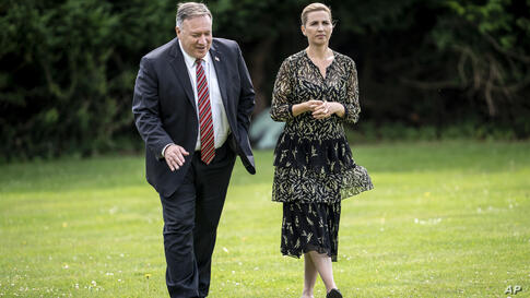 US Secretary of State Mike Pompeo, left, speaks with Danish Prime Minister Mette Frederiksen in the garden of Marienborg Castle…
