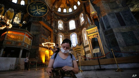 People visit the Byzantine-era Hagia Sophia, one of Istanbul's main tourist attractions in the historic Sultanahmet district of…