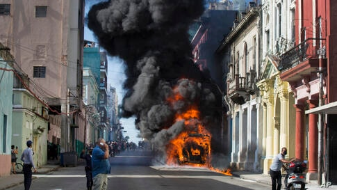 An empty parked bus burns on Belascoain Street in Havana, Cuba, Wednesday, July 29, 2020. Neither residents nor police at the…