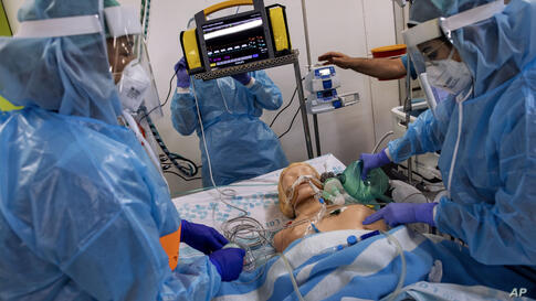 Israeli medical workers operate a ventilation machine on a training mannequin during an exercise of the new COVID-19 department…