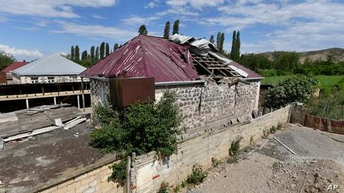 A damaged house is seen after shelling by Armenian forces in the Tovuz region of Azerbaijan, Tuesday, July 14, 2020. Skirmishes…
