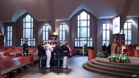 Members of an Honor Guard place the casket of the late Rep. John Lewis, D-Ga., for the funeral service at Ebenezer Baptist…