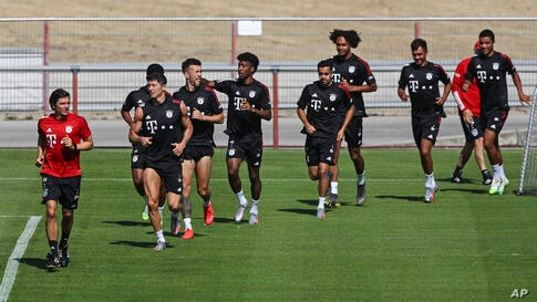 Bayern's players exercise during a training session of Bayern Munich in Munich, Germany, Thursday, July 23, 2020. Bayern will…