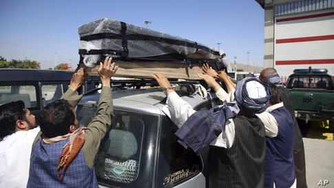 Families receive bodies of their relatives who drowned after their boat sank in Turkey's Lake Van, at the Hamid Karzai…