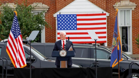 """Vice President Mike Pence speaks at a """"Cops for Trump"""" campaign event at the police station, Thursday, July 30, 2020, in…"""