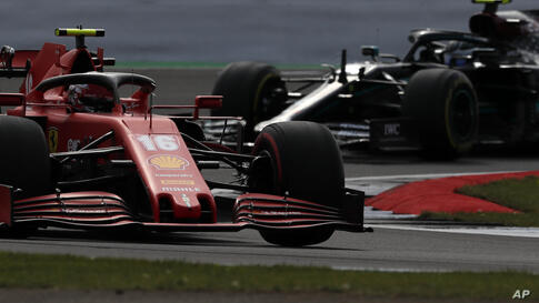 Ferrari driver Charles Leclerc of Monaco steers his car followed by Mercedes driver Valtteri Bottas of Finland during the…