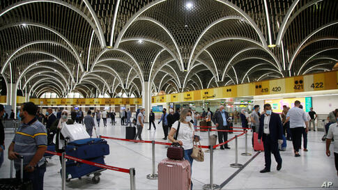 Passengers prepare to travel at an airport in Baghdad, Iraq, Thursday, July 23, 2020. Iraq opened its airports to commercial…