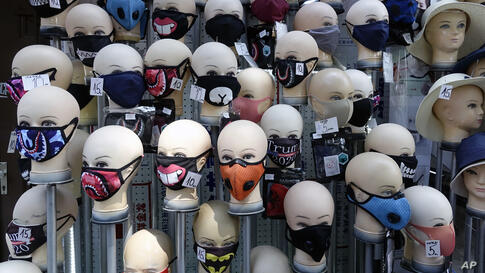 Masks placed on mannequins heads are displayed outside a shop in Sarajevo's main street, Bosnia, Monday, July 27, 2020…