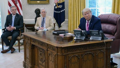 President Donald Trump meets with Senate Majority Leader Mitch McConnell, center, and House Minority Leader Kevin McCarthy in…