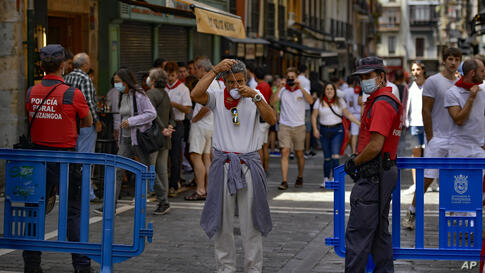 Residents, wearing white clothes and traditional red scarves, take to the streets on the day the ''txupinazo'' would usually…