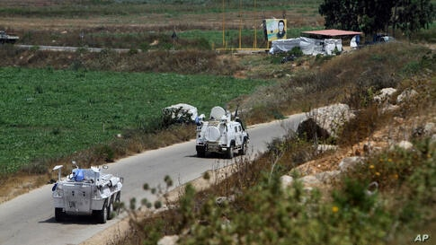 UN vehicles manned by Spanish peacekeepers patrol on the Lebanese side of the Lebanese-Israeli border in the southern village…