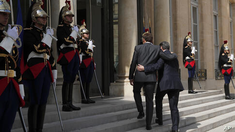 French President Emmanuel Macron, left, welcomes Cypriot President Nicos Anastasiades on his arrival at the Elysee Palace, in…