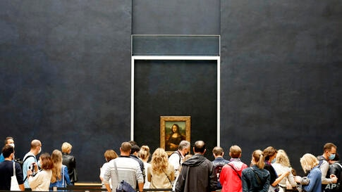 Visitors watch the Leonardo da Vinci's painting Mona Lisa, in Paris, Monday, July 6, 2020. The home of the world's most famous…