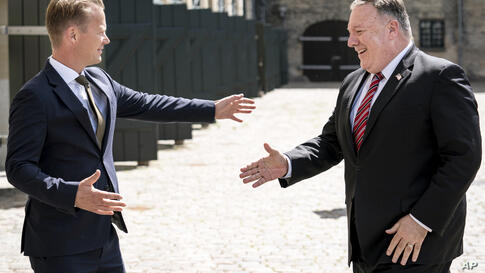 Danish Foreign Minister Jeppe Kofod, left, greets US Secretary of State Mike Pompeo, upon his arrival to the Ministry of…