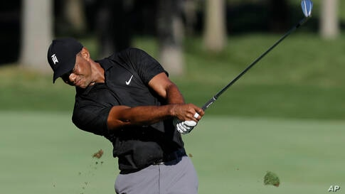 Tiger Woods hits from the 13th fairway during a practice round for the Memorial golf tournament, Tuesday, July 14, 2020, in…